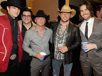 Actor Ashton Kutcher, musicians Jay DeMarcus, Kenny Chesney, Jason Aldean and Jake Owen pose backstage at the 47th Annual Academy Of Country Music Awards held at the MGM Grand Garden Arena on April 1, 2012 in Las Vegas, Nevada. (Photo by Rick Diamond/Getty Images for ACM)