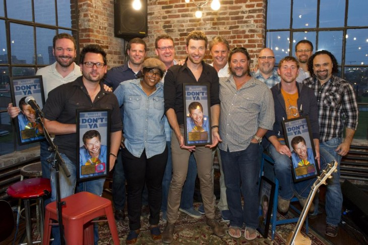 Pictured L-R: Front Row: Co-writer/producer Chris DeStefano, Camille Alston, Brett Eldredge, Chris Stacey (SVP Promotion, WMN), co-writer Ashley Gorley, Lou Ramirez (Regional Promo Mgr – SW, WMN). Back Row: Josh Van Valkenburg (Dir. A&R, EMI Music Publishing), Rob Baker (RLB Artist Management, LLC), Peter Strickland (EVP & GM, WMN), Scott Hendricks (Sr. VP A&R, WMN),  Kevin Herring (VP National Promotion, WMN) and Chad Schultz (National Dir. Radio Interactive Mktg., WMN)