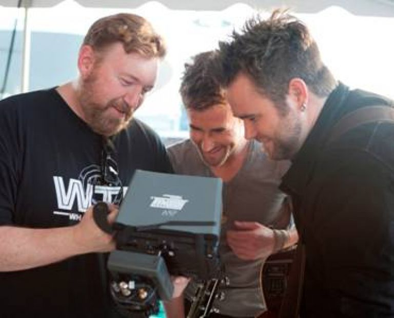 "Pictured, left to right, in downtown Nashville while shooting The Swon Brothers' debut music video, ""Later On,"" are: Roman White, Director, and Colton and Zach Swon. (Photo Credit: Allister Ann)"